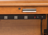 Large Power Strip Integrated into Desk