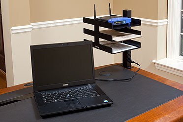 power organizer tower with power outlets at the desk top