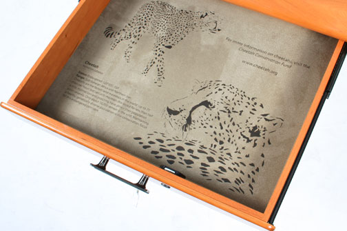 cheetah's engraved in desk drawer